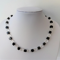 Black and clear glass cube bead necklace.