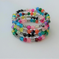 Sparkly multicoloured and Tibetan silver memory wire wrap bracelet.