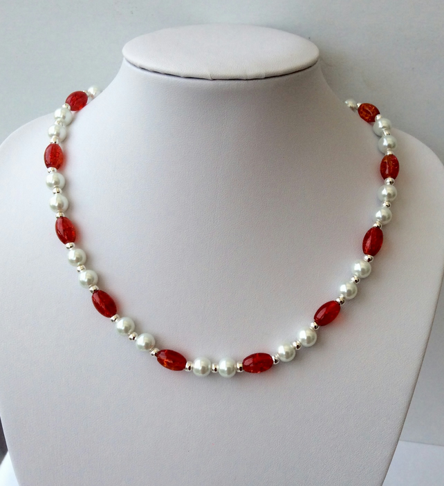 White glass pearl and oval red-orange crackle glass bead necklace.