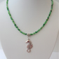 Green seed bead mix necklace with sea horse pendant.
