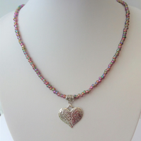 Purple seed bead mix necklace with heart pendant.
