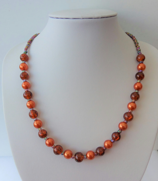 Burnt orange and purple glass and acrylic beaded necklace.