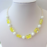 Yellow and white glass bead necklace.