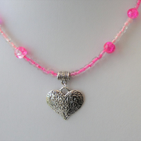 Pink seed bead and pink crackle bead necklace with heart pendant
