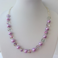 Purple pearl, purple and pink swirl and clear glass bead necklace.