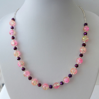 Pink and yellow crackle, faceted purple and silver bead necklace.