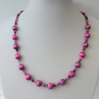 Purple puffed melon and mixed seed bead necklace.