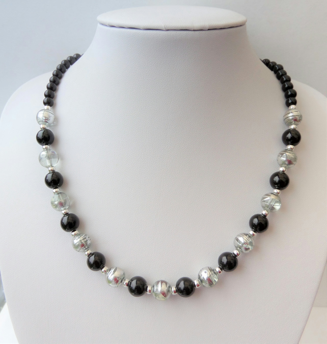Black, clear and silver coloured glass bead necklace