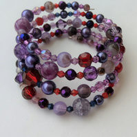Purple mixed bead memory wire wrap bracelet