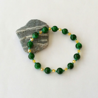 Elasticated green and yellow glass bead bracelet