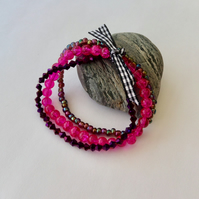 Set of 3 purple and pink glass bead elasticated stacking bracelets