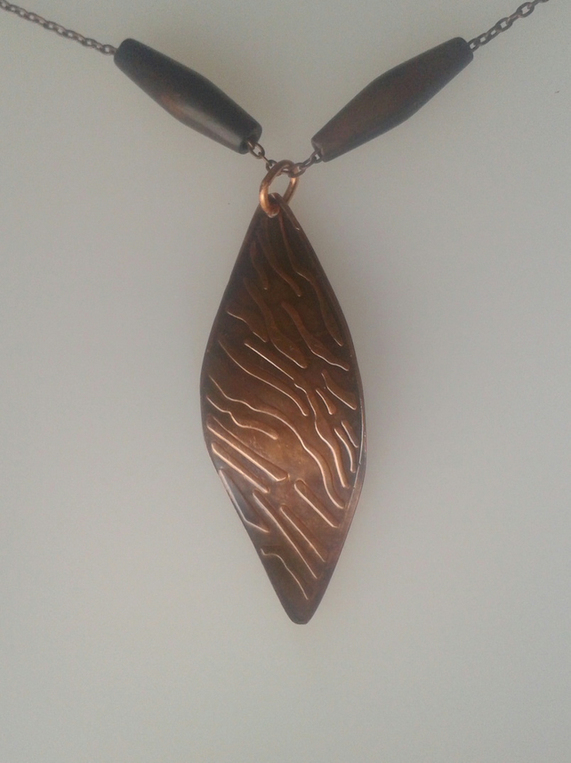 Copper leaf pendant imprinted with a tiger-striped pattern,  P47B