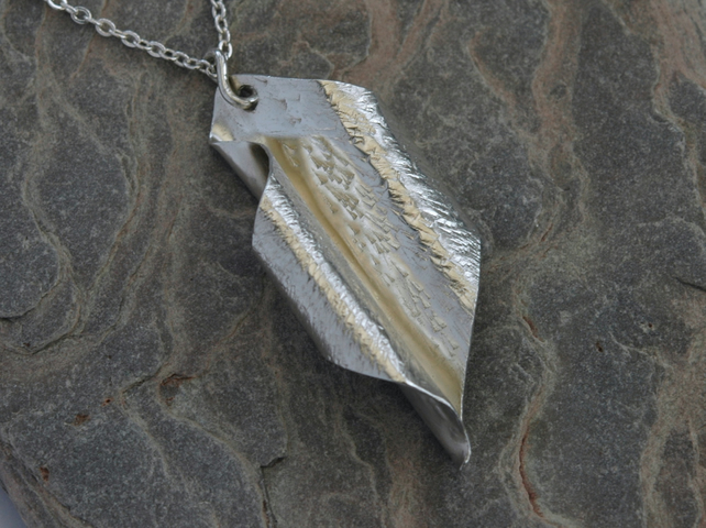 Scrolled leaf pendant in sterling silver,  hammered and hallmarked