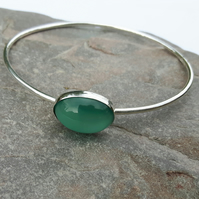Silver bangle with turquoise cat's eye cabochon