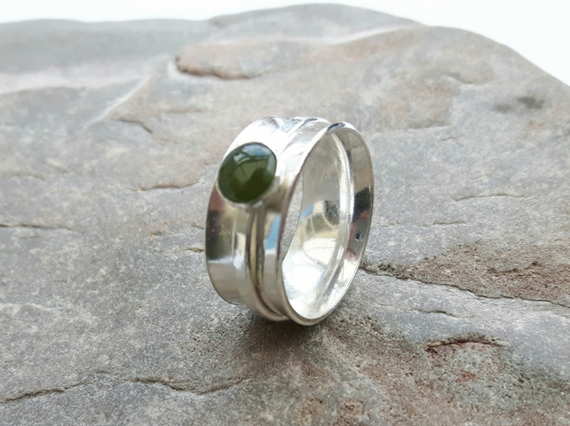 Sterling silver spinner ring with green nephrite jade gemstone