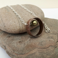 Copper and Silver Ring Pendant with Mobile Pearl Bead