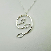 Silver Spiral Pendant with Three Open Leaves