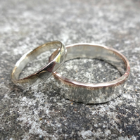 A pair of silver and gold wedding rings