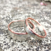 A Pair of Silver and Copper Wedding Bands