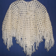 Adorable, crocheted poncho in cream. Suitable for ages 3-5 years.
