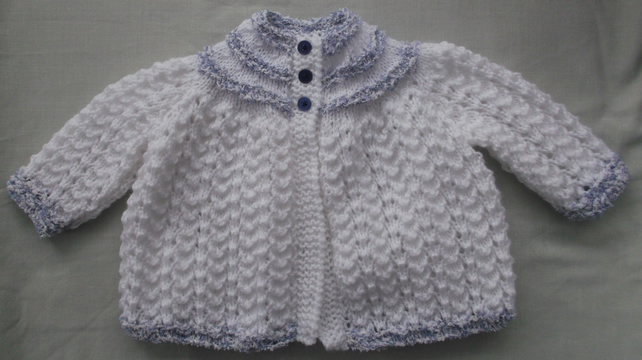 Delicate white with blue trim, matinee coat for  0-3 months.