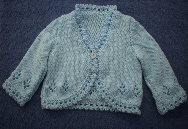 Delightful, pretty pale blue cardigan for 6-12 months.