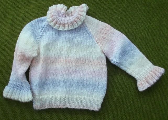 Beautiful and frilly, pastel multi Jumper for 3-6 months.