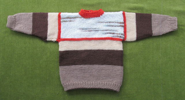Jumper in shades of Browns and Cream for 12-24months.