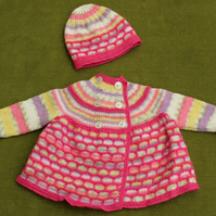 Lovely bright pink and random Cardigan with matching hat. For 6-12 months.
