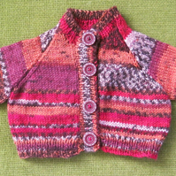 Tiny Wool Cardigan in Random Reds, Oranges & Browns. Perfect for your Newborn.