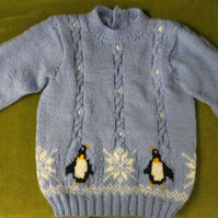 Gorgeous Blue Cable Jumper with Penguins and Snowflakes. Age 3-4 years.