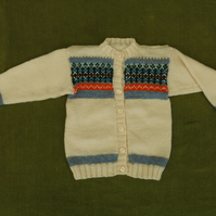 Gorgeous Natural White Cardigan with Multicoloured Fairisle Yoke . For 3 years.