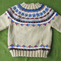 Cosy Nordic Style Jumper in Honey Beige and Multi. For ages 18-24 months.