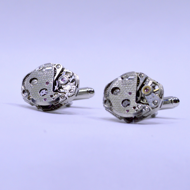Cufflinks with oval swiss watch movements 168