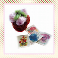 Knitted pink plant and seed packets