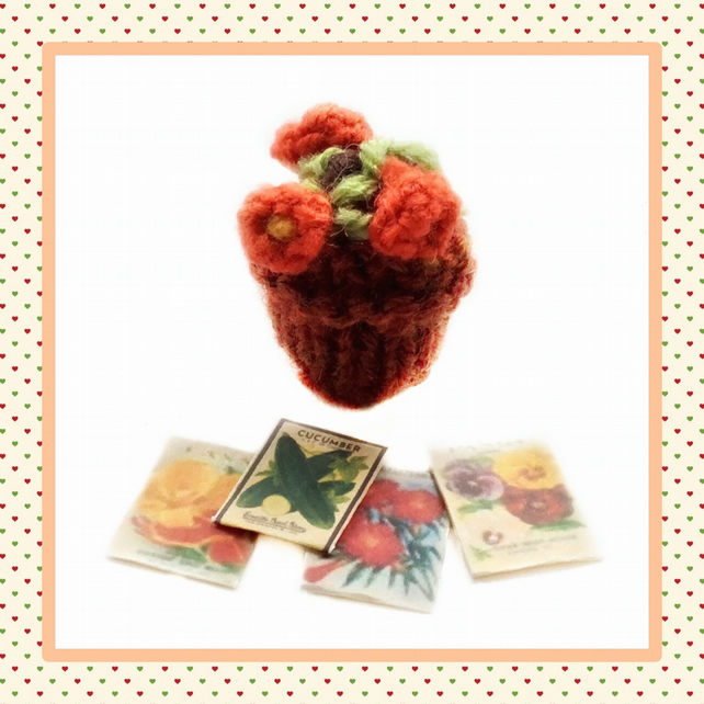 Knitted orange plant and seed packets