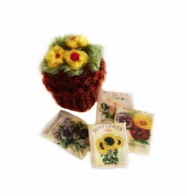 Knitted yellow plant and seed packets