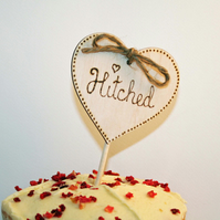 Beautiful Wooden Cake Topper With the wording Hitched