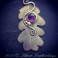 Sterling silver and copper oak leaf with amethyst cabochon.