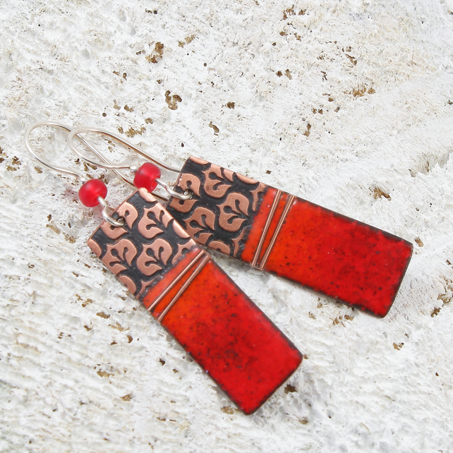Fire red enamel and copper earring with retro pattern