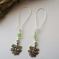 'The Green Man' Pagan earrings with green man and glass beads, extra long wires.