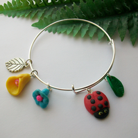 'Cottage Garden' Expandable charm bangle with polymer clay ladybird and flowers