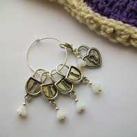 Locked away - Set of five, four stitch markers and progress keeper. Knitting