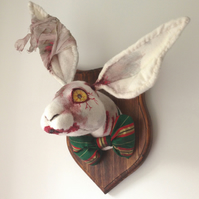 Freaky zombie bunny trophy. Halloween scary hare. Undead bloody rabbit