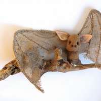 Hessian bat and driftwood wall sculpture. Gold leaf jute textile art animal.