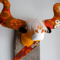 Orange retro 60s 70s Highland coo trophy. Flowery fabric taxidermy cow head.