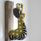 Quirky zebra slug garden pest trophy. Fun textile fauxidermy art. Handmade snail