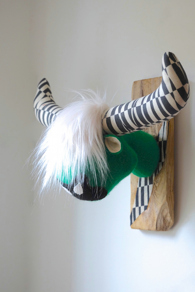 Green, black and white Highland coo cow taxidermy. Quirky Scottish fauxidermy