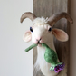 Thistle munching mini cotton goat. Animal head sculpture. Fauxidermy fun