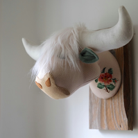 Scottish coo faux taxidermy head. Vegetarian quirky fauxidermy trophy. Flower